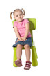 little child sits on a chair