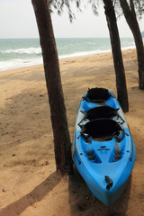 Blue kayak on the beach