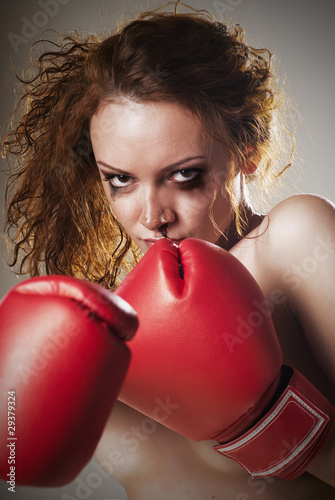 angry woman face with fists in boxing gloves