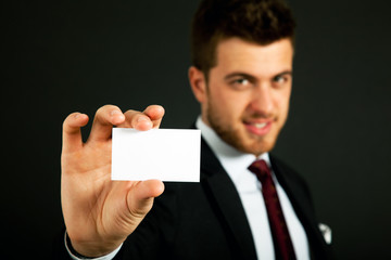 Businessman offering a businesscard