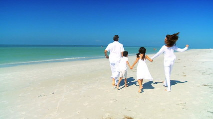 Healthy Family Skipping Along the Beach filmed at 60FPS