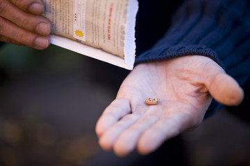 A man holding a seed, close-up