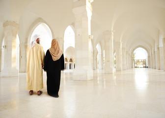 Muslim arabic couple inside big oriental empty modern building