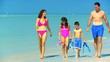 Family in Swimwear Walking in the Shallows filmed 60FPS