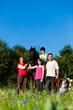 Family with children posing with horse