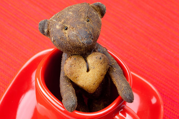 teddy bear  handmade and cookie  in the form of heart  in a cup