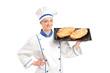 Smiling female baker showing freshly baked breads