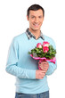 Young smiling man holding a bouquet of flowers