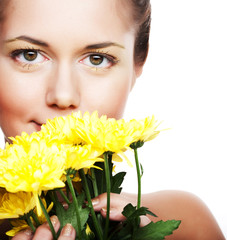 image of a young woman with yellow chrysanthemums