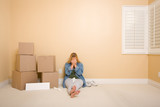 Upset Woman on Floor Next to Boxes and Blank Sign poster
