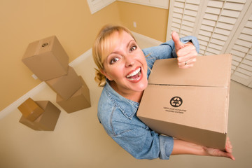 Happy Thumbs Up Woman Moving Boxes