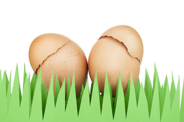 Red Easter eggs on a paper grass