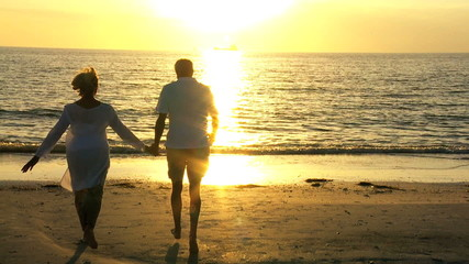 Retired Couple Running to the Waves at Sunset filmed 60FPS
