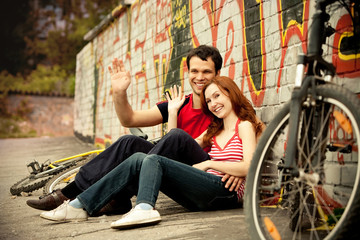Young couple and bikes