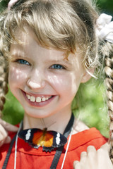 Happy child with butterfly on neck.
