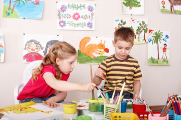 Children painting in play room.