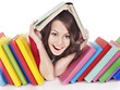 Girl with pile color book.