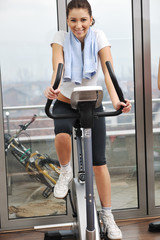 womanworkout  in fitness club on running track machine