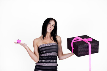 Woman choosing between small and large gifts