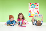 Young kids reading books