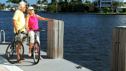 Seniors on Bicycles Beside a Marina filmed at 60FPS