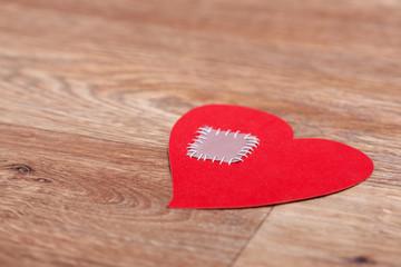 Broken heart lost on wooden floor background