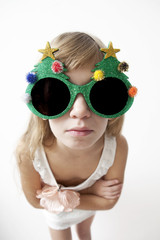 girl wearing big round glasses  making silly expression
