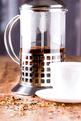 french press with herbal tea