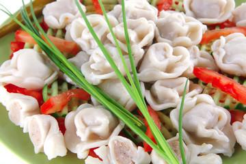 dumplings served with vegetables on green