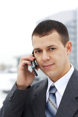 Successful young businessman talking on the phone