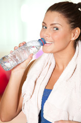Woman drink cold water after sport train.