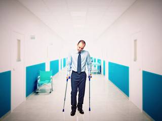 man with crutch in hospital