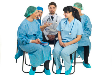 Doctors conversation on chairs