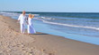 Seniors Walking on the Beach Barefoot filmed at 60FPS