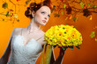 Lovely redhead bride with a bouquet of flowers