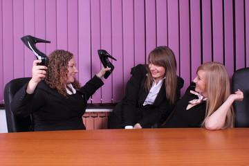 three young women having fun in the office