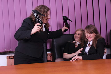 three young women having fun in the office