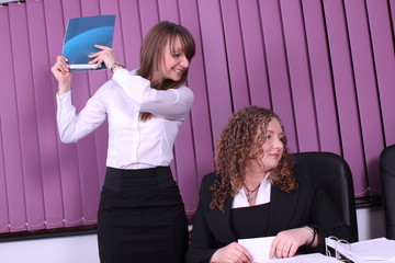 two young women working in the office