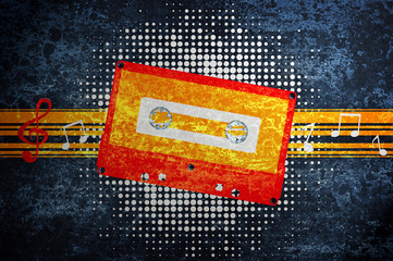 Musical grunge background with audiocassette.