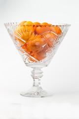 Tangerines in a crystal vase