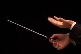 Concert conductor hands with baton poster