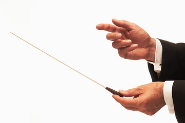 Music conductor hands with baton
