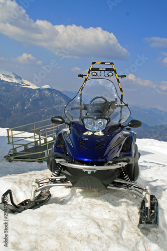 snowmobile parked in the mountain on snowy slopes