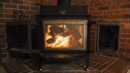 Wood stove Fireplace against brick wall