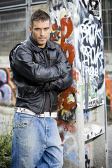 man in graffiti background