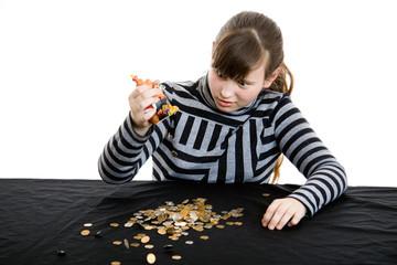 Girl gets money from money-box