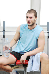 man drink water at fitness workout