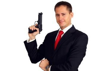 An agent posing with his gun