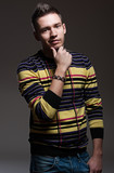 handsome man in striped pullover poster