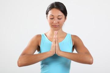 Eyes closed meditating beautiful young woman